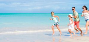 family vacation, family running on the beach